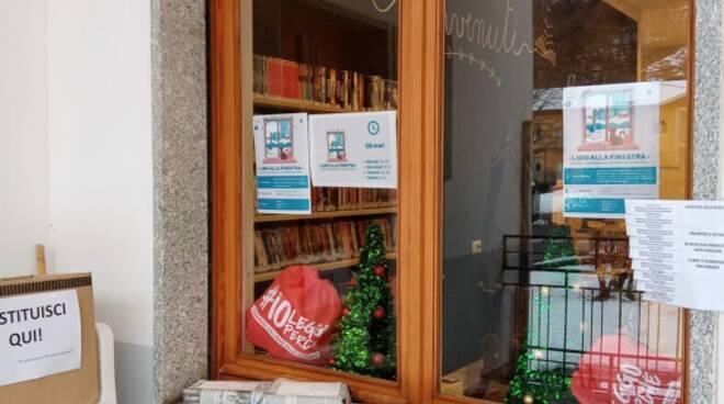 biblioteca ezio alberione chiusa pesio libri alla finestra